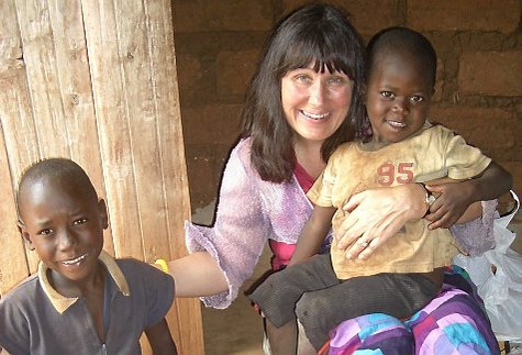 Dr Susan Wilson with two children helped by the charity she founded